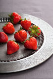 Strawberry on vintage plate Stock Photos