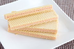 Strawberry wafer. On white plate close - up stock photos