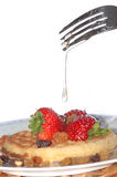 Strawberry on waffle. Breakfast made of waffle, strawberries and nuts Royalty Free Stock Image