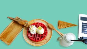 Strawberry waffle flavor served in a wooden tray on Aquamarine background. stock photos