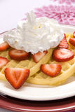 Strawberry waffles with whipped cream royalty free stock images