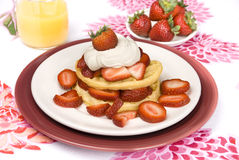 Strawberry waffles with whipped cream Stock Image