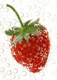 Strawberry in water. With bubbles Royalty Free Stock Photography