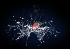Strawberry and water Royalty Free Stock Photography