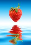 Strawberry water. Beautiful Strawberry Above Fresh Water Stock Photo