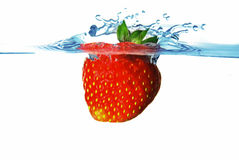 Strawberry in water Stock Photos