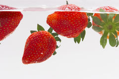 Strawberry in water. Strawberries dipping in fresh water Royalty Free Stock Photos