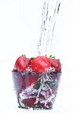 Strawberry with water. Red strawberry in a glass with water on white background Royalty Free Stock Images