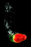 Strawberry in water. Sinking strawberry in water, bubbles, Tasty Royalty Free Stock Images