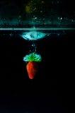 Strawberry water splash on black background Royalty Free Stock Images