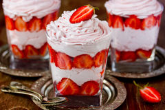 Strawberry with whipped cream in a glass Royalty Free Stock Images