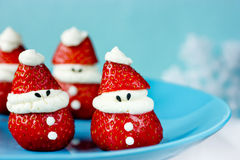 Strawberry whipped cream Santa Claus - Merry Christmas and Happy Royalty Free Stock Photos