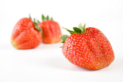 Strawberry on white background - close-up Stock Photos