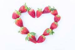 Strawberry on white background fruit`s healthful cordial, useful foto de stock