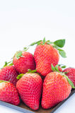 Strawberry on white background fruit`s healthful cordial, useful fotografia de stock