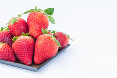 The Strawberry on white background fruit`s healthful cordial, useful Royalty Free Stock Image