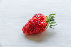 Strawberry on a white background. Red, juicy, ripe strawberry on a white background Stock Images