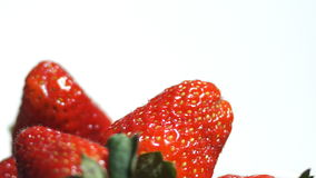 Strawberry on white background spinning stock footage