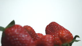 Strawberry on white background spinning stock video footage
