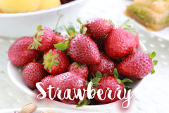 Strawberry on white bawl. With sign on it stock image