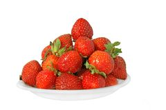 Strawberry on white plate Stock Photography
