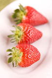 Strawberry on white plate Royalty Free Stock Image
