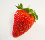 Strawberry on white textured background Royalty Free Stock Photos