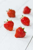 Strawberry on a white wooden background Stock Photography