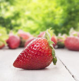Strawberry on white wooden table Stock Images