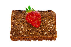 Strawberry on the whole grain bread Royalty Free Stock Photos