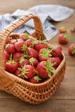 Strawberry in wicker basket Royalty Free Stock Photo