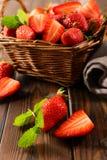 Strawberry in wicker basket royalty free stock photos