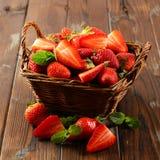 Strawberry in wicker basket royalty free stock image