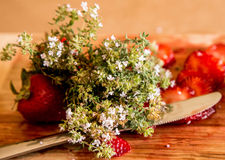 Strawberry with wildflowers royalty free stock photos