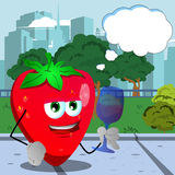 Strawberry with wine glass in the city park with speech bubble Royalty Free Stock Images