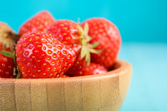 Strawberry Wood Bowl On Blue Background Royalty Free Stock Images