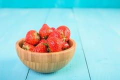 Strawberry Wood Bowl On Blue Background Stock Photos