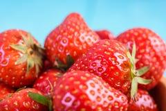 Strawberry Wood Bowl On Blue Background Stock Image