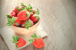 Strawberry on wood bowl Stock Images