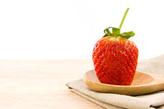Strawberry on wood spoon with napkin Stock Image