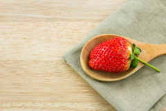 Strawberry on wood spoon with napkin Royalty Free Stock Photos