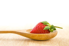 Strawberry on wood spoon. Stock Photos