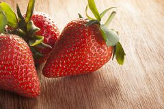 Strawberry on table. The strawberry on wood table Royalty Free Stock Photography