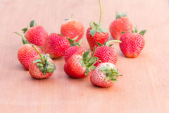 Strawberry  on woodden table. Strawberry with leaf on woodden table Royalty Free Stock Photos