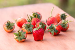 Strawberry on woodden table. Strawberry with leaf on woodden table Royalty Free Stock Image