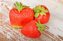 Strawberry on wooden background, DOF Royalty Free Stock Images