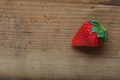 Strawberry on a wooden background Royalty Free Stock Image