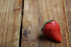 Strawberry on a wooden background Stock Images
