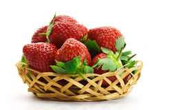 Strawberry in wooden basket isolated on white background. Basket with strawberries isolated on white background Royalty Free Stock Photography
