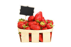 Strawberry in wooden basket with price sign Royalty Free Stock Photo